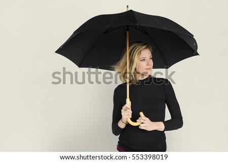Caucasian Lady Black Umbrella Concept #553398019