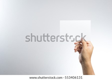 Hand hold blank photo paper card  on white background