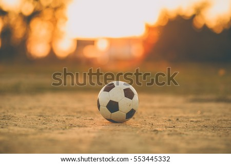 A ball for street soccer football under the sunset ray light. Film picture style.