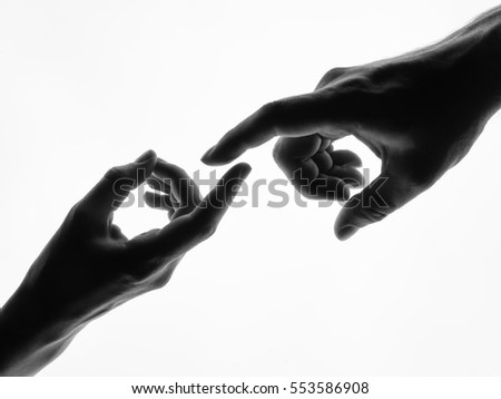 Finger Touching hands silhouette man woman white background couple feeling love. Black and white photo picture Royalty-Free Stock Photo #553586908