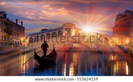 Gondola near Rialto Bridge in Venice, Italy Royalty-Free Stock Photo #553624159