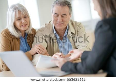 Senior couple meeting financial adviser for investment                 #553625662
