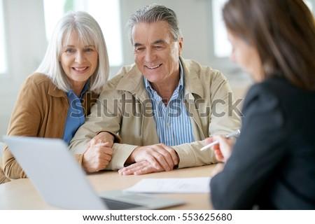 Senior couple meeting financial adviser for investment                 #553625680
