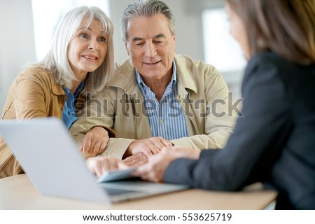 Senior couple meeting financial adviser for investment                 #553625719