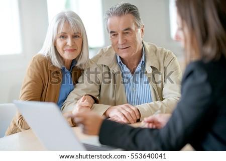 Senior couple meeting financial adviser for investment                 #553640041