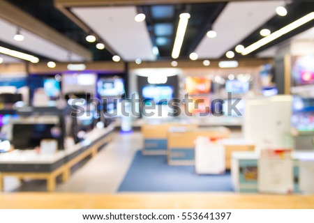 Abstract Blur Background of Home Appliance Store, TV or Television Department Royalty-Free Stock Photo #553641397