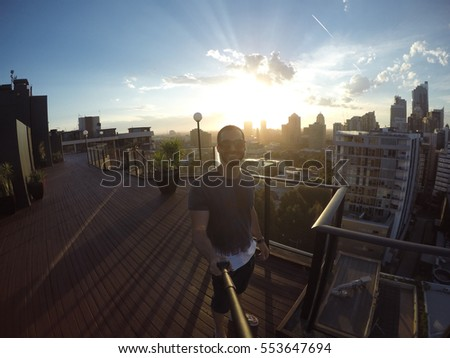 Man taking a selfie with Sydney Skyline on background, Australia #553647694