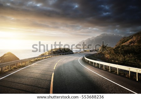 oad by the sea in sunrise time, Lofoten island, Norway #553688236