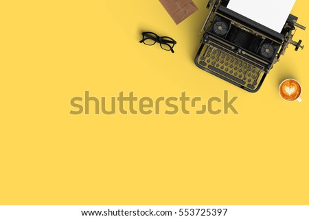 vintage typewriter paper and cup of coffee latte art on the color background  #553725397