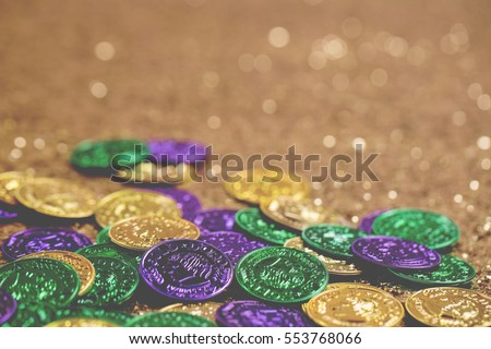 Mardi Gras Coins on Gold Glitter