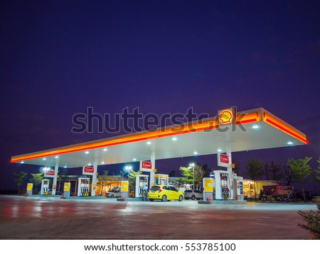 Nakhon Ratchasima, Thailand - December 29, 2016: Shell gas station blue sky background during sunset. Royal Dutch Shell sold its Australian Shell retail operations to Dutch company Vitol in 2014 #553785100