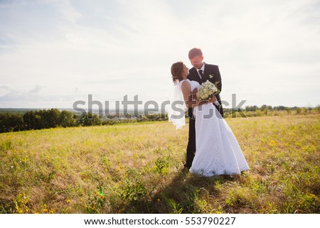 couple bride and groom on field background. #553790227