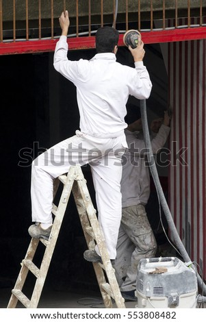 painter man professional working at risk to drop , concept  danger at work