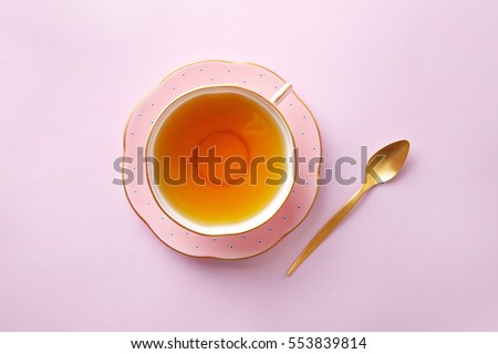 Tea cup on pastel pink background. Top view #553839814