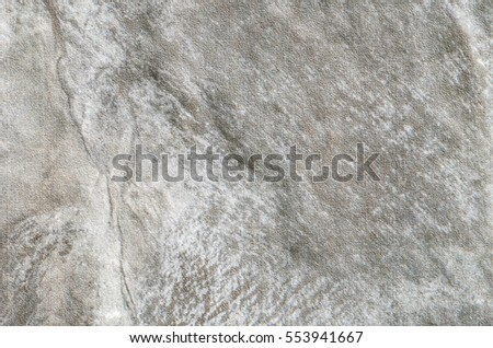 Closeup surface at stone pattern at stone brick wall in the garden textured background #553941667