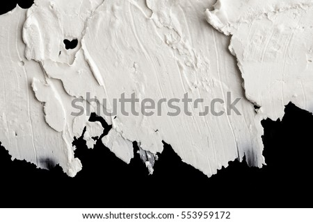 Structural plaster white on a black background. White Cream. paint smear. Plasticine. Royalty-Free Stock Photo #553959172