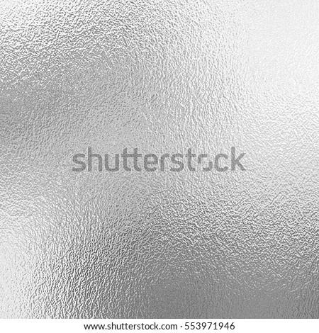 Shiny silver foil texture, grey metallic decorative background Royalty-Free Stock Photo #553971946