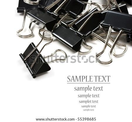 Black paper clips on a pure white background with space for text