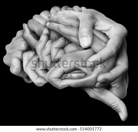 Human brain made with hands, different hands are wrapped together to form a brain. Black background.