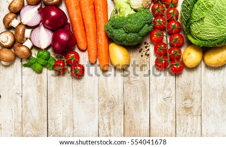 Healthy food background. Healthy food concept with fresh vegetables or ingredients for cooking. Top view with copy space. Wooden background. #554041678