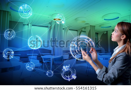 young woman holding smart phone and modern room interior, wireless communication network concept. smart home, smart house. #554161315
