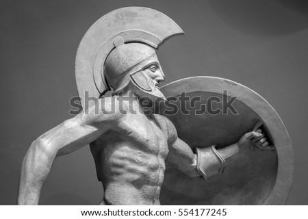 Head in helmet Greek ancient sculpture of warrior. Royalty-Free Stock Photo #554177245