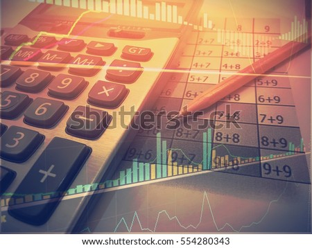 Business line and chart with calculator and pencil in vintage tone and light #554280343