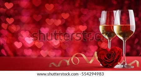 Valentines wine and rose,heart background Royalty-Free Stock Photo #554294983