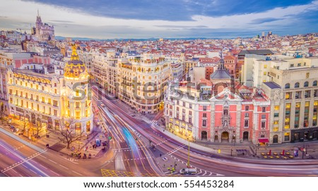 Downtown Madrid, Spain, where the Calle de Alcala meets the Gran Via. These are two of the most famous and busy streets in Madrid. #554453284