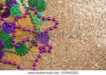 Mardi Gras Coins and Beads on Gold Glitter