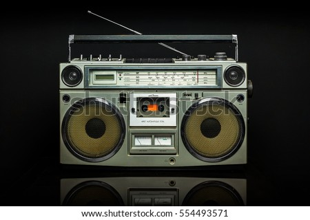 Vintage Silver Radio boom box on black background #554493571