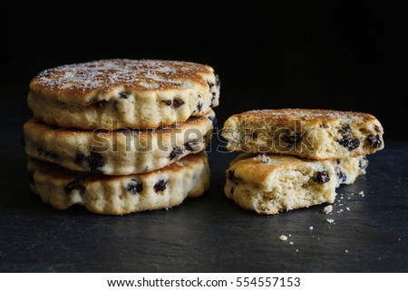Welsh cakes a traditional griddle cake made with flour and dried fruit on a slate background
