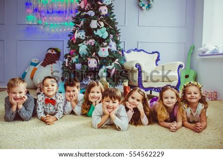 Preschool children next to the Christmas tree #554562229