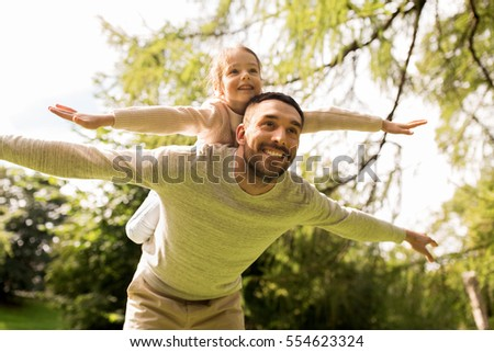 family, parenthood, fatherhood and people concept - happy man and little girl in having fun in summer park #554623324