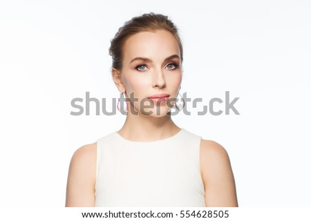 jewelry, luxury, wedding and people concept - smiling woman in white dress wearing pearl earrings over white background #554628505