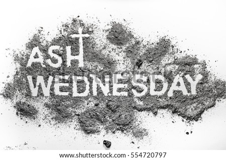 Ash wednesday word written in ash and christian cross symbol as a religion concept Royalty-Free Stock Photo #554720797