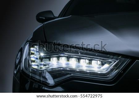 headlight of  modern prestigious car close up #554722975