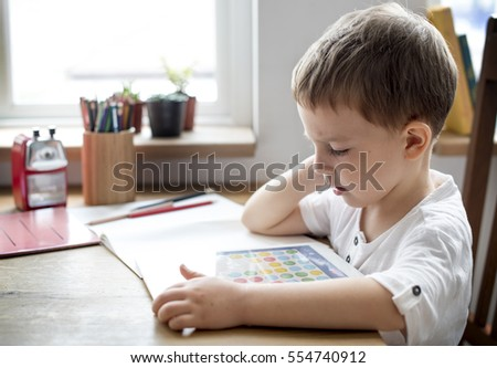Son Boy Kid Playing Techie Digital Device Royalty-Free Stock Photo #554740912