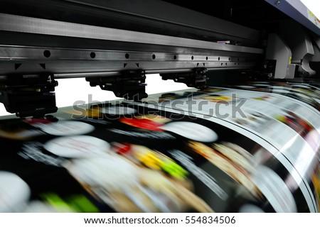 Large printer format inkjet working Royalty-Free Stock Photo #554834506