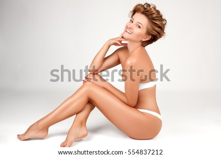 Beautiful Woman with smooth soft skin in white lingerie. Beauty and spa #554837212