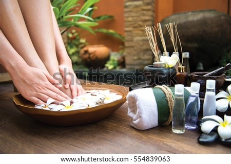 Thai Spa treatment and product  body care for female pedicure foot or feet and manicure toe spa in water, Thailand. Healthy Concept Royalty-Free Stock Photo #554839063