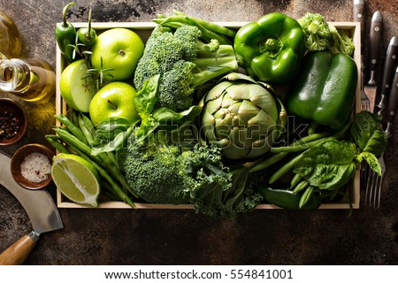 Variety of green vegetables and fruits in a crate on the table #554841001