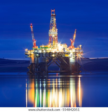 Semi Submersible Oil Rig during Sunrise at Cromarty Firth in Invergordon, Scotland #554842051