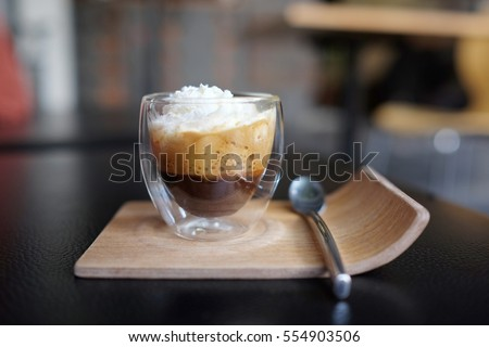 Espresso con panna coffee. Espresso con panna, which means espresso with cream in Italian, is a single or double shot of espresso topped with whipped cream. #554903506