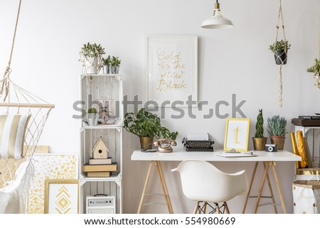 Room with gold design and stylish furniture