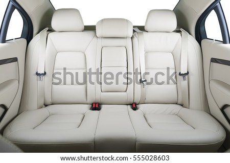 Back passenger seats in modern luxury car, frontal view, white leather Royalty-Free Stock Photo #555028603