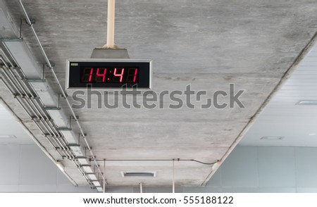 Digital clock in train station #555188122