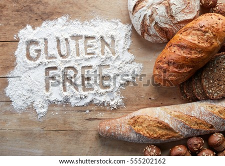 Gluten free bread on wooden background from top view #555202162