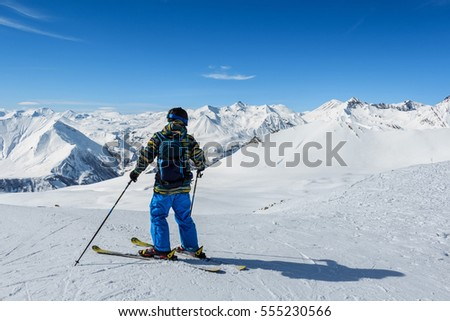 Skier standing in front of mountains #555230566