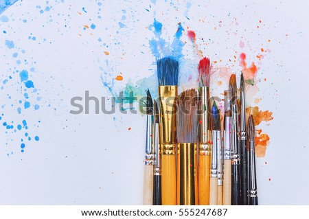 artistic brushes on wooden background Royalty-Free Stock Photo #555247687